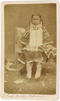Native American:Photography, Carte de Visite - Studio portrait of the daughter of Black Teeth. Circa 1880. Length 4 1/4 in. Width 2 1/2 in.. This Sioux...