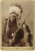 """Photographs, Cabinet Card - Studio portrait of Sioux """"Chief White Deer, U.S.S."""". Circa 1893. Length 6 1/8 in. Width 4 1/4 in.. U.S. I... (Total: 1 Item Item)"""