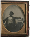 Antiques:Black Americana, Cased Ambrotype of a Seated Black Man. A beautiful cased 1/6 plateambrotype of a black man seated and reclining with his ar...