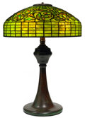 Art Glass:Tiffany , TIFFANY STUDIOS OAK LEAF TABLE LAMP. Bronze lamp base withgreen and yellow tiled domed shade in an oak leaf mot...