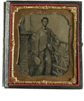 Antiques:Black Americana, A Fine Tintype of a Black Boy Standing by a Fence This ninth platecased tintype, surrounded by brass mat, includes rose tin...