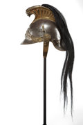 Decorative Arts, Continental:Other , A CONTINENTAL PATINATED METAL GRENADIER PARADE HELMET . Early 20thcentury. 10 inches high (25.4 cm). ...
