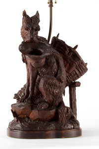 A BLACK FOREST CARVED WOOD LAMP WITH SHADE 20th century 31 inches high (78.7 cm) (including shade)