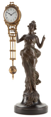 A JUNGHAN SWING ARM SPELTER CLOCK Circa 1880 Marks: Marie 13-3/4 inches high (34.9 cm)