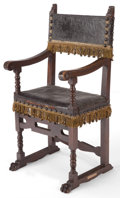 Furniture : Continental, A SPANISH RENAISSANCE STYLE WOOD AND LEATHER ARM CHAIR . 19thcentury . 46-1/2 inches high x 22-3/4 inches wide x 19-1/2 inc...