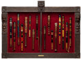 Decorative Arts, British:Other , A CASED SET OF SEVENTEEN ENGLISH PAINTED AND GILT WOOD TRUNCHEONS .19th and early 20th centuries . 32 inches high x 49 inch...