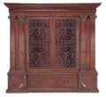 Furniture : Continental, AN ITALIAN RENAISSANCE STYLE WALNUT, GLASS AND IRON BOOKCASE . 17thcenturies (in part). 102 inches high x 110-3/4 inches wi...