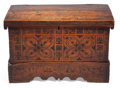 Furniture : Continental, A SWISS CEDAR CHEST . 18th century . 19-1/2 inches high x 30 incheswide x 15-1/2 inches deep (49.5 x 76.2 x 39.4 cm). Elt...