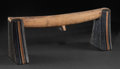 African, A SOUTH AFRICAN WOOD NECKREST . Zulu, 20th century. 6-1/2inches high x 16-1/2 inches long (16.5 x 41.9 cm). ...