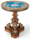 Furniture : French, A LOUIS XVIII STYLE PORCELAIN, GILT BRONZE AND WOOD TRIPOD TABLE .Probably Paris, France, circa 1850-1880. 33 inches high x...