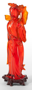 Asian:Chinese, A CHINESE AMBER FIGURE OF GUANYIN . 20th century . 9-3/4 incheshigh (24.8 cm). ...