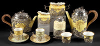 AN ELEVEN PIECE STAFFORDSHIRE PORCELAIN TEA SERVICE WITH WILLIAM COMYNS SILVER OVERLAY 1893-1894 Marks to porc