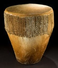 African, AN UGANDAN WOOD AND HIDE DRUM . Ganda, 20th century . 20inches high x 17-1/2 inches diameter (50.8 x 44.5 cm). ...