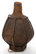 Decorative Arts, Continental, A WOVEN JUG VESSEL . Circa 1900. 19 inches high (48.3 cm). EltonHyder III Collection Formerly at the University of Texas ...