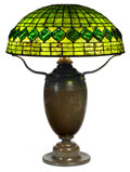 Art Glass:Tiffany , TIFFANY STUDIOS TURTLEBACK TILE BORDER TABLE LAMP. Bronzelamp base with green and yellow leaded glass shade in ...