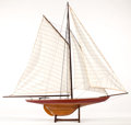 Maritime:Decorative Art, SHIP MODEL OF A TRADITIONAL RACING YACHT. Presented on small woodenstand. 35 x 37 inches (88.9 x 94.0 cm). ...