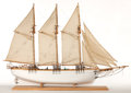 Maritime:Decorative Art, 'EAGLE' SHIP MODEL. An impressive, three-masted, full-rigged vesselartfully displayed at full sail.. Presented on wood base...