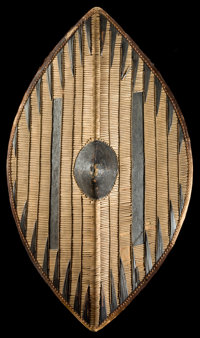 AN UGANDAN WOOD AND HIDE SHIELD Early 20th century 30 inches high (76.2 cm)