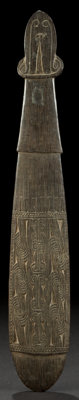AN OCEANIC CARVED WOOD SPATULATE CLUB Massim, Trobriand Islands 25-1/4 inches long (64.1 cm)
