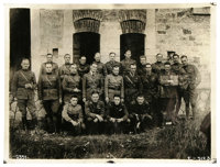 """Two Group Photos of American WWI Airmen With Rickenbacker, as follows: 22 fliers standing before a biplane, 9"""" x 6..."""