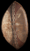 Paintings, AN EAST AFRICAN PAINTED LEATHER SHIELD . Maasai/Nandi, 20th century . 38-3/4 inches high x 21-1/2 inches wide (98.4 x 54...