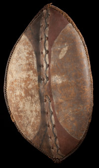 AN EAST AFRICAN PAINTED LEATHER SHIELD Maasai/Nandi, 20th century 38-3/4 inches high x 21-1/2 inch