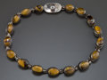 Jewelry, AN ANTONIO PINEDA SILVER AND TIGER'S EYE NECKLACE. Antonio Pineda, Taxco, Mexico, circa 1950. Marks: ANTONIO (over) TA...