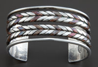 A WILLIAM SPRATLING SILVER AND COPPER CUFF BRACELET William Spratling, Taxco, Mexico, circa 1950 Marks: WS