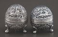 Silver Holloware, Continental:Holloware, A PAIR OF INDIAN SILVER PEPPER SHAKERS . Maker unknown, India,circa 1900. Unmarked. 1-5/8 inches high (4.1 cm) (tallest). 1...(Total: 2 Items)