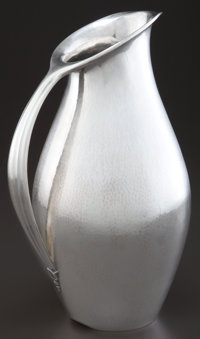 A GEORG JENSEN SILVER PITCHER DESIGNED BY JOHAN ROHDE Designed by Johan Rohde, Copenhagen, Denmark, circa 1929