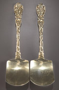 Silver Flatware, British:Flatware, A PAIR OF CHARLES ELEY GEORGE IV SILVER GILT SERVING SHOVELS .Charles Eley, London, England, circa 1827-1828. Marks: (lion ...(Total: 2 Items)