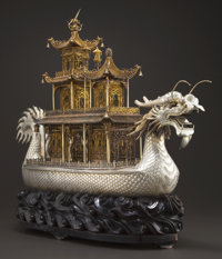 A MONUMENTAL CHINESE SILVER AND SILVER GILT DRAGON BOAT ON STAND Maker unknown, China, 20th century Unmarked