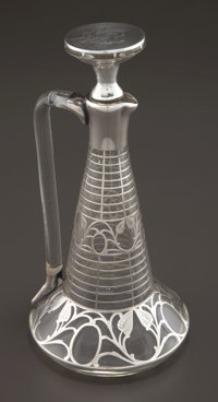 AN AMERICAN GLASS DECANTER WITH SILVER OVERLAY Maker unknown, American, circa 1900-1910 Marks: STERLING, 53