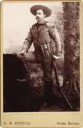 Photography:Cabinet Photos, KANSAS SCOUT WITH BOWIE KNIFE, HOLSTERED PISTOL AND WINCHESTER1880s. Great cabinet card studio image of a Kansas scout wit...(Total: 1 Item)