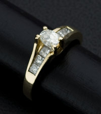 Terrific Oval & Princess Cuts Lady's Diamond Gold Ring