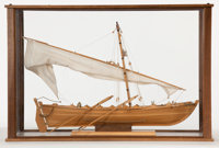 SCALE MODEL OF A WHALEBOAT Finely modeled in wood and canvas. Presented in wood and glass case. 19 x 29 x 12