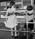 Photographs:20th Century, MARTIN ELKORT (American, b. 1929). Puppy Love, Coney IslandBoardwalk, Brooklyn, circa 1951. Gelatin silver, printed lat...