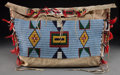 American Indian Art:Beadwork and Quillwork, A SIOUX BEADED HIDE TIPI BAG. c.1890...