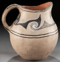 American Indian Art:Pottery, A COCHITI BLACK-ON-CREAM PITCHER. c. 1940...