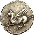 Ancients:Greek, Ancients: Corinthia, Corinth. Ca. 345-307 B.C. AR stater (21 mm,7.15 g). Pegasos flying left; koppa below / Helmeted head of Athenal...