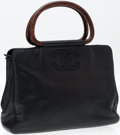 Luxury Accessories:Bags, Heritage Vintage: Chanel Black Caviar Leather Bag with Wood TopHandles. ...