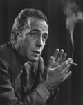 Photographs, YOUSUF KARSH (Canadian, 1908-2002). Humphrey Bogart, 1946. Gelatin silver, printed later. 19-3/4 x 15-7/8 inches (50.2 x...
