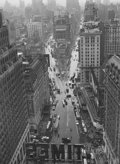 Photographs:20th Century, LOU STOUMEN (American, 1917-1991). Times Square, 1940.Gelatin silver, later. 12-3/8 x 9-1/8 inches (31.4 x 23.2 cm).Si...