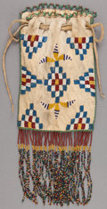 American Indian Art:Beadwork and Quillwork, AN APACHE BEADED HIDE DRAWSTRING POUCH...