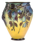 Art Glass:Galle, GALLE GLASS PRUNES BLOW-OUT VASE . Yellow glass overlaid with blue and mold-blown with plums amidst leafy branch...