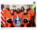 Autographs:Celebrities, Space Shuttle Discovery (STS-116) Crew-Signed Color Photo....
