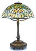 Art Glass:Tiffany , TIFFANY STUDIOS BELLFLOWER TABLE LAMP. Bronze lamp base withgreen and yellow leaded glass shade in a bellflower...