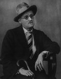 Photographs:20th Century, BERENICE ABBOTT (American, 1898-1991). James Joyce, 1928.Gelatin silver, printed later. 13-1/2 x 10-1/2 inches (34.3 x ...