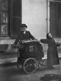 Photographs, EUGÈNE ATGET (French, 1857-1927). Organ Grinder and Street Singer, 1898. Gelatin silver, printed later by Berenice Abbot...