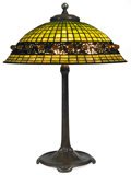 Art Glass:Tiffany , TIFFANY STUDIOS GEOMETRIC TABLE LAMP WITH FAVRILE BALLEMBELLISHMENT. Bronze lamp base with green tiled domed sh...